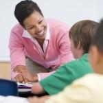 african american teacher young kids